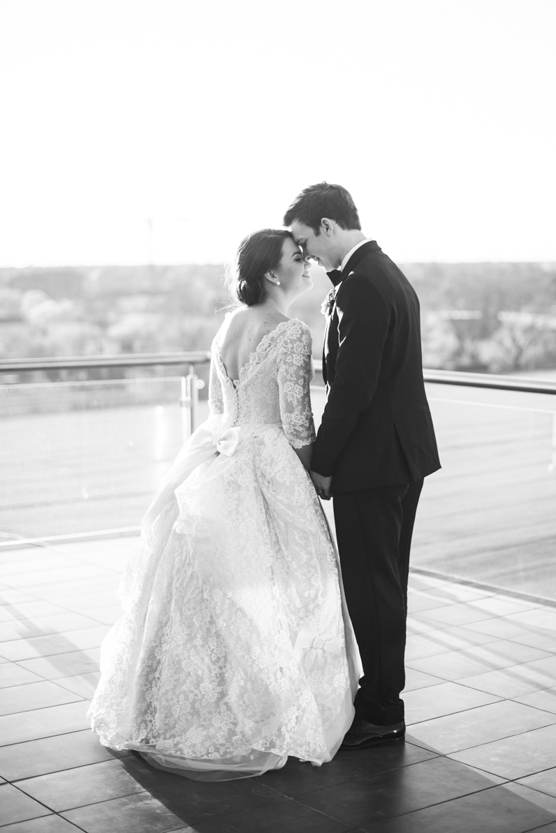 Navy, Wine, and Gold Charleston Wedding | Bride and Groom rooftop sunset portraits