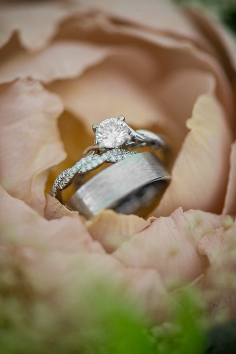 Elegant and Intimate Winery Wedding | Ring shot in pink peony sola wood flower