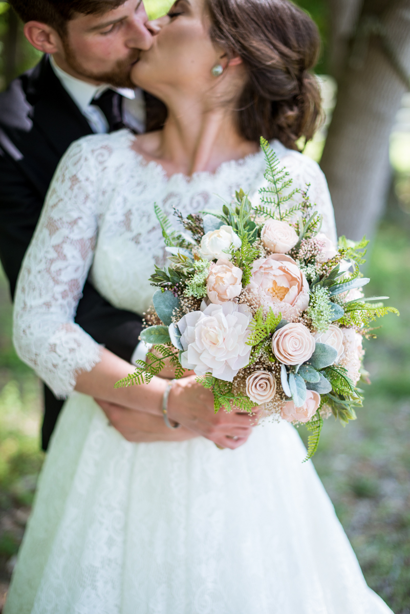 Elegant and Intimate Winery Wedding | Bride and groom portraits with sola wood flower bouquet