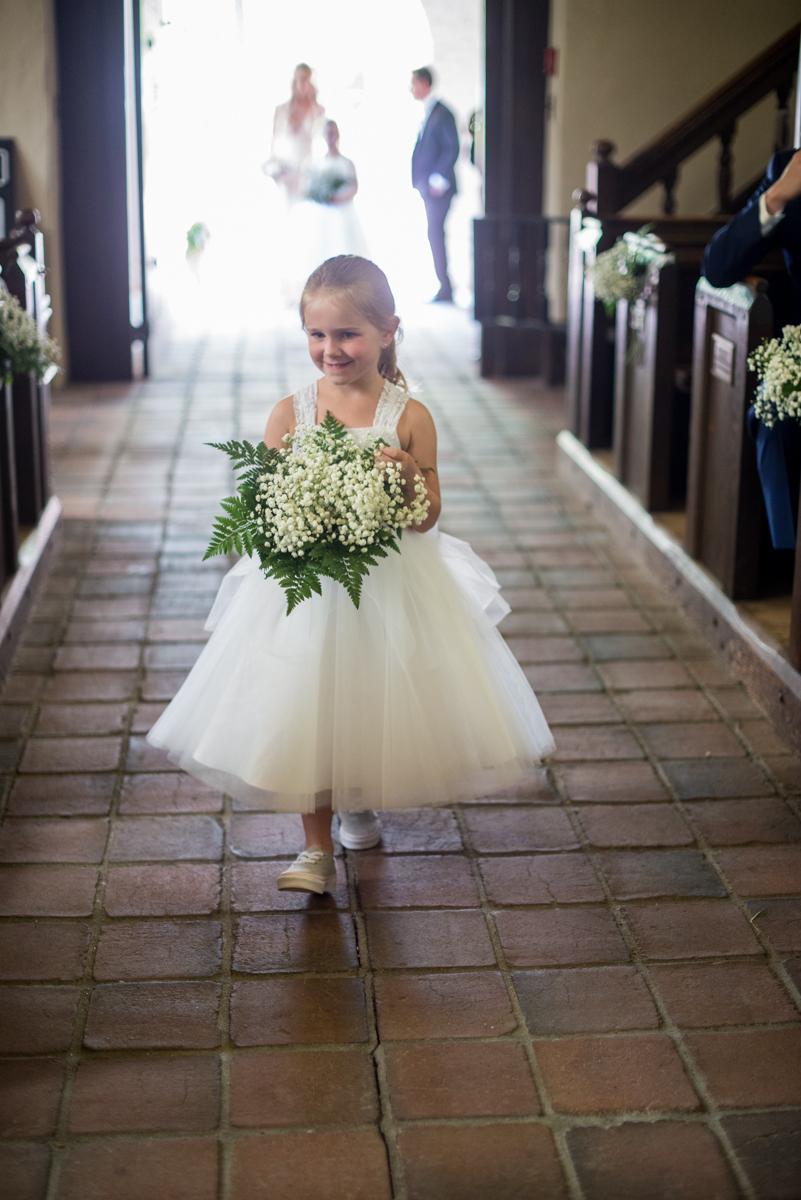 Elegant and Intimate Winery Wedding | Flower girl in white dress