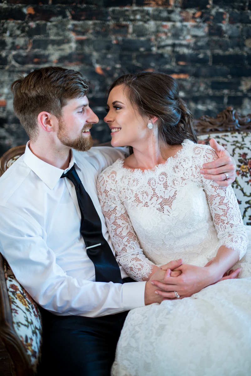 Elegant and Intimate Winery Wedding | Bride and groom portraits on couch