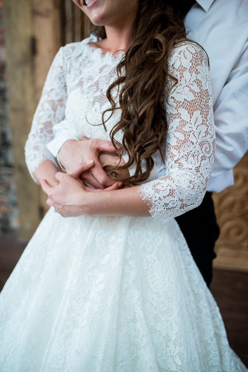 Elegant and Intimate Winery Wedding | Bride and groom holding each other