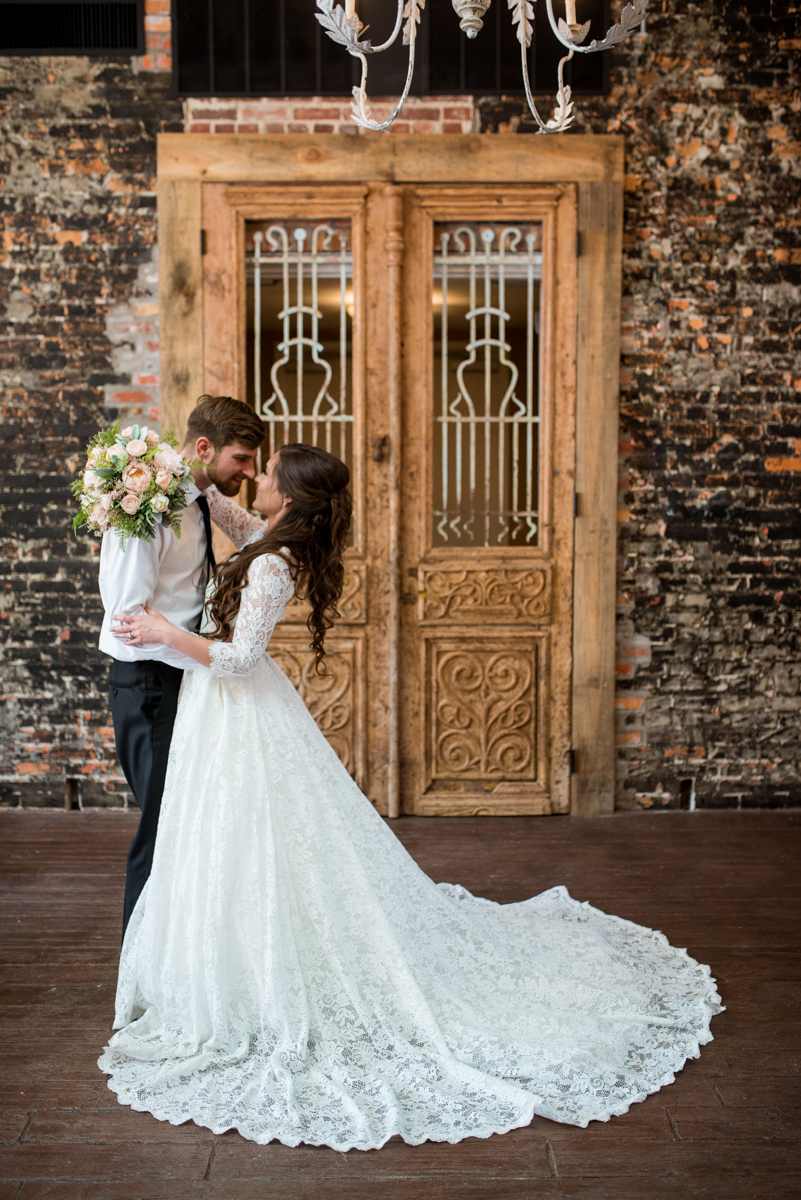 Elegant and Intimate Winery Wedding | Bride and groom portrait with exposed brick