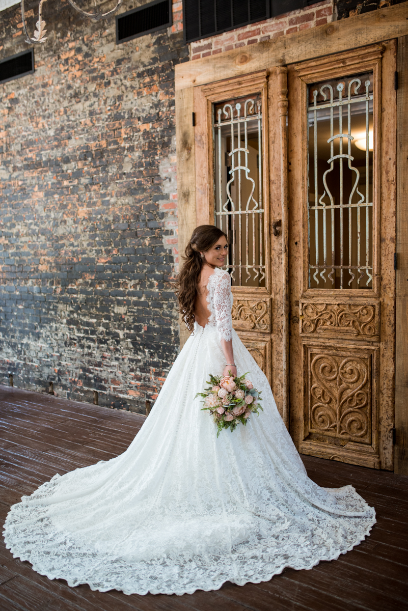 Elegant and Intimate Winery Wedding | Bridal portrait in all-over lace dress