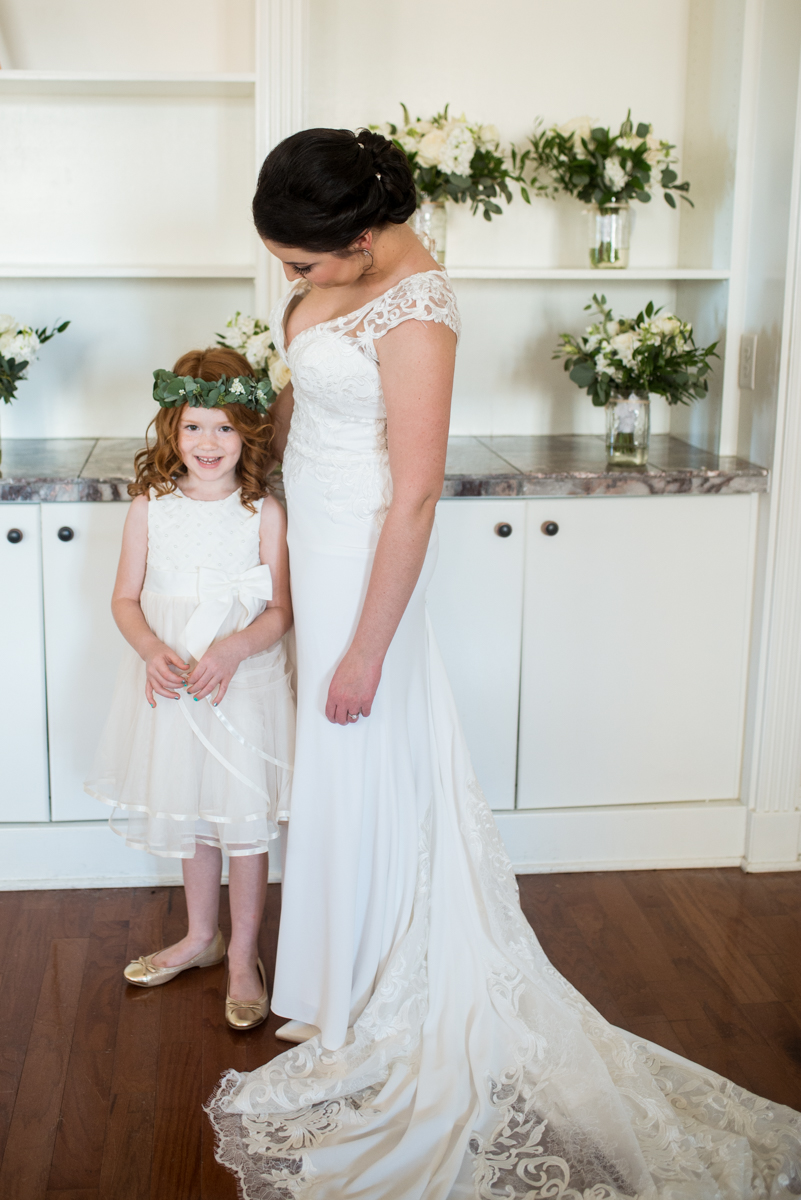 Minimalist White and Green Summer Wedding | Flower Girl with Bride and Flower Crown