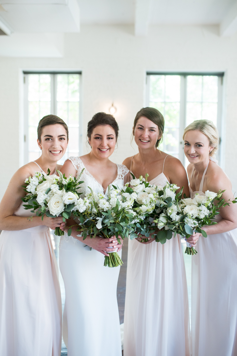 Minimalist White and Green Summer Wedding | Blush Bridesmaid Dresses with White Bouqueuts