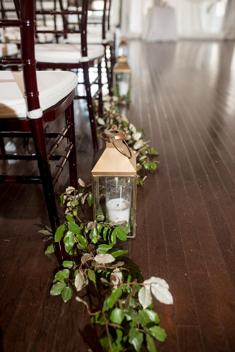 Minimalist White and Green Summer Wedding | Greenery and Lantern Ceremony Aisle