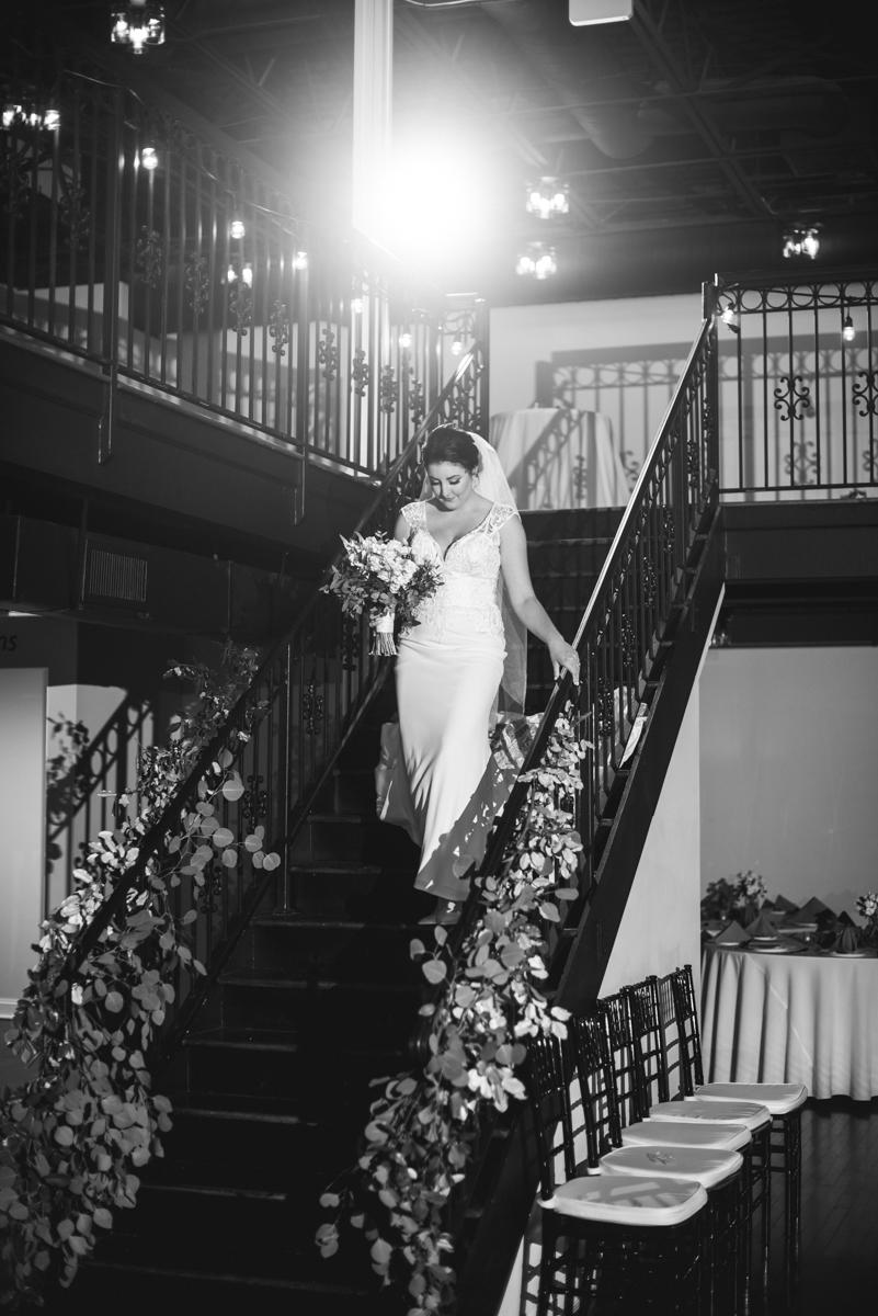 Minimalist White and Green Summer Wedding | Bride walking down the steps