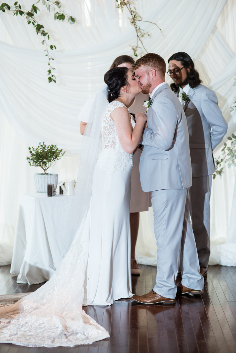 Minimalist White and Green Summer Wedding | Wedding ceremony first kiss