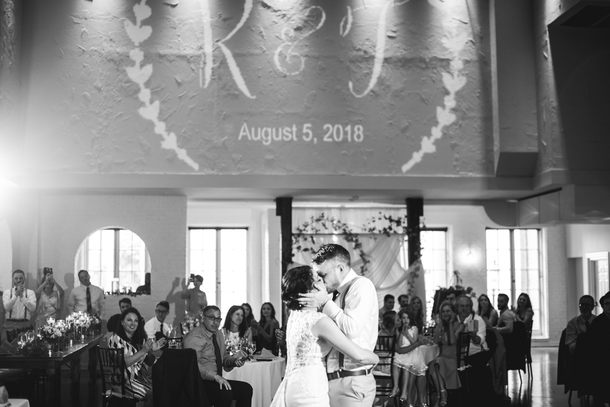 Minimalist White and Green Summer Wedding | First dance with lighted monogram