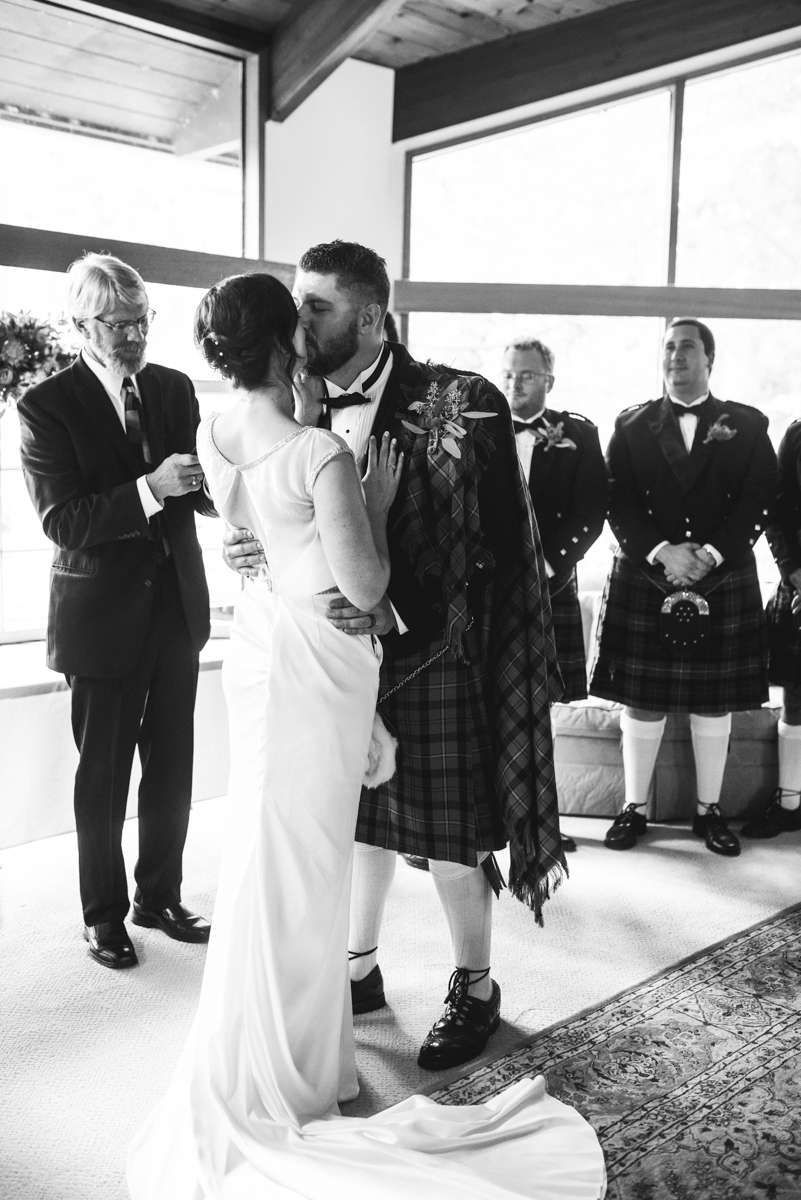 Scottish Themed Wedding with Burgundy, Navy, and Copper | Bride and groom first kiss