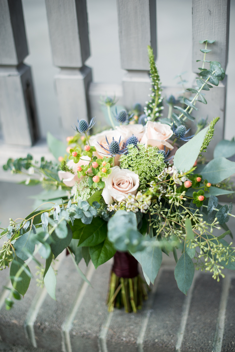 Blush and Burgundy Garden Wedding | Blush rose, blue thistle, and eucalyptus bouquet