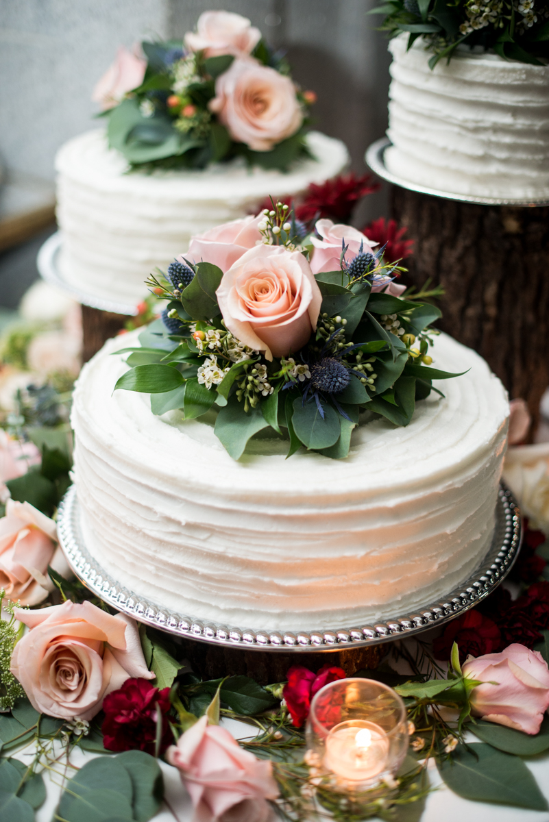 Blush and Burgundy Garden Wedding | Simple white wedding cake with flower decorations