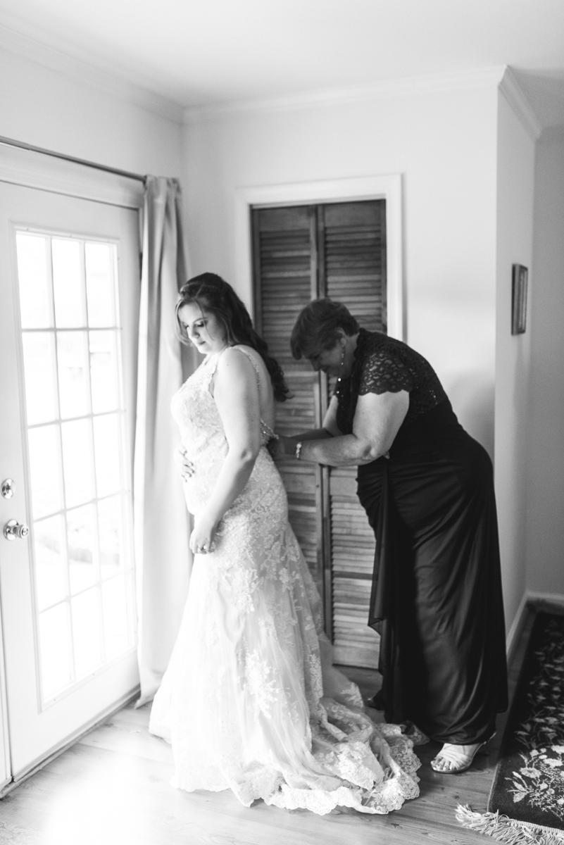 Gold, Blue, and Burgundy Fall Wedding | Bride getting ready