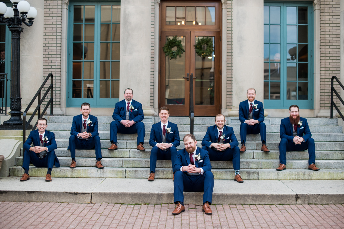 Burgundy and Pale Blue Winter Wedding | Navy blue groomsmen portraits