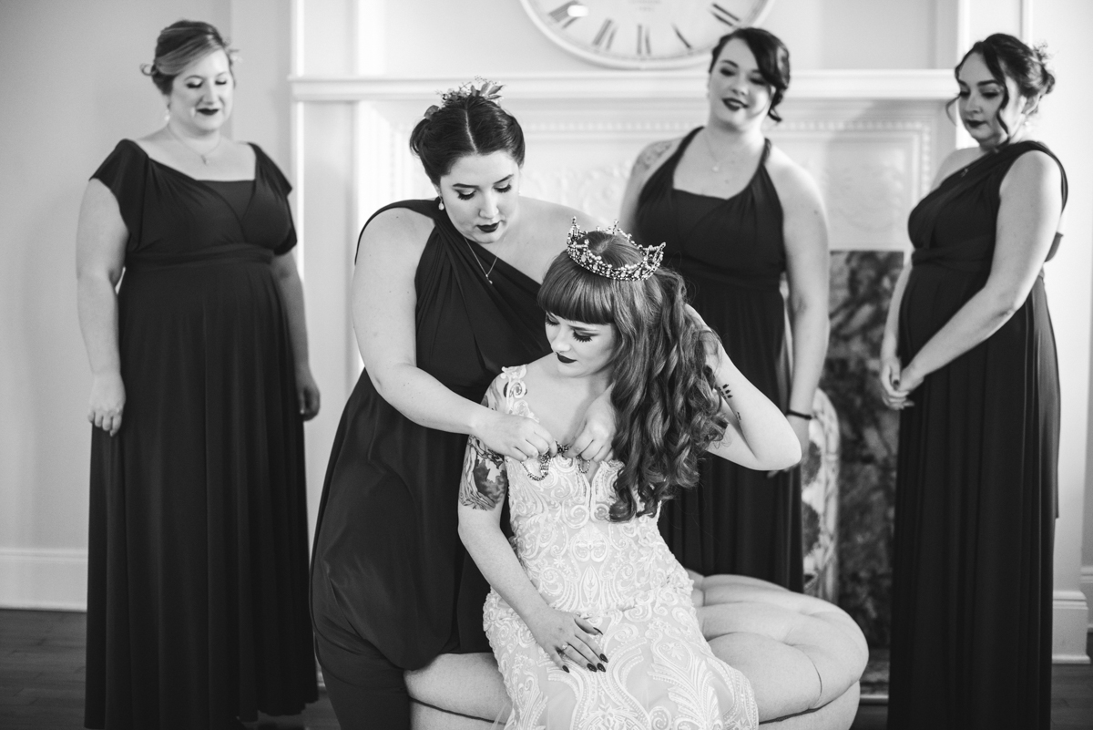 Lush Winter Wedding with Red and Gray | Bride getting ready with bridesmaids
