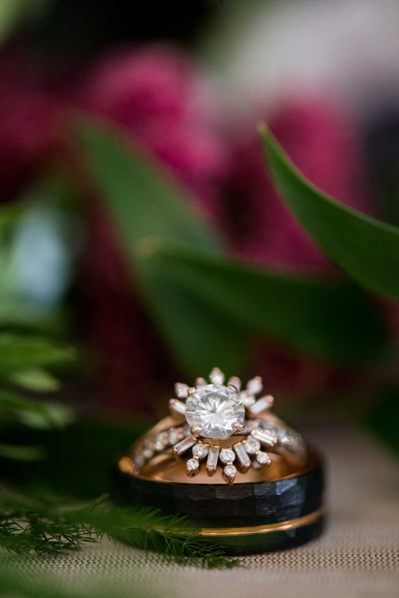 Lush Winter Wedding with Red and Gray | Vintage Ring Shot with Flowers