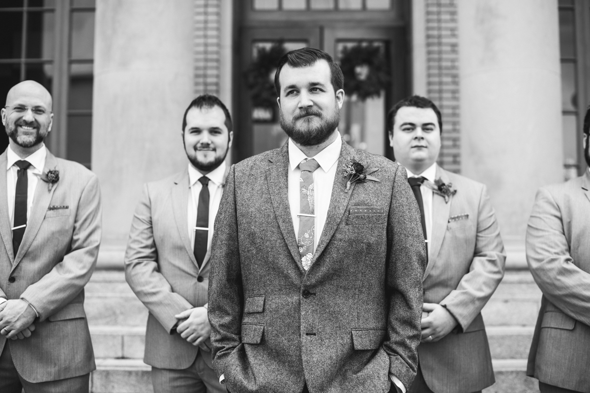 Lush Winter Wedding with Red and Gray | Classic groomsmen portrait