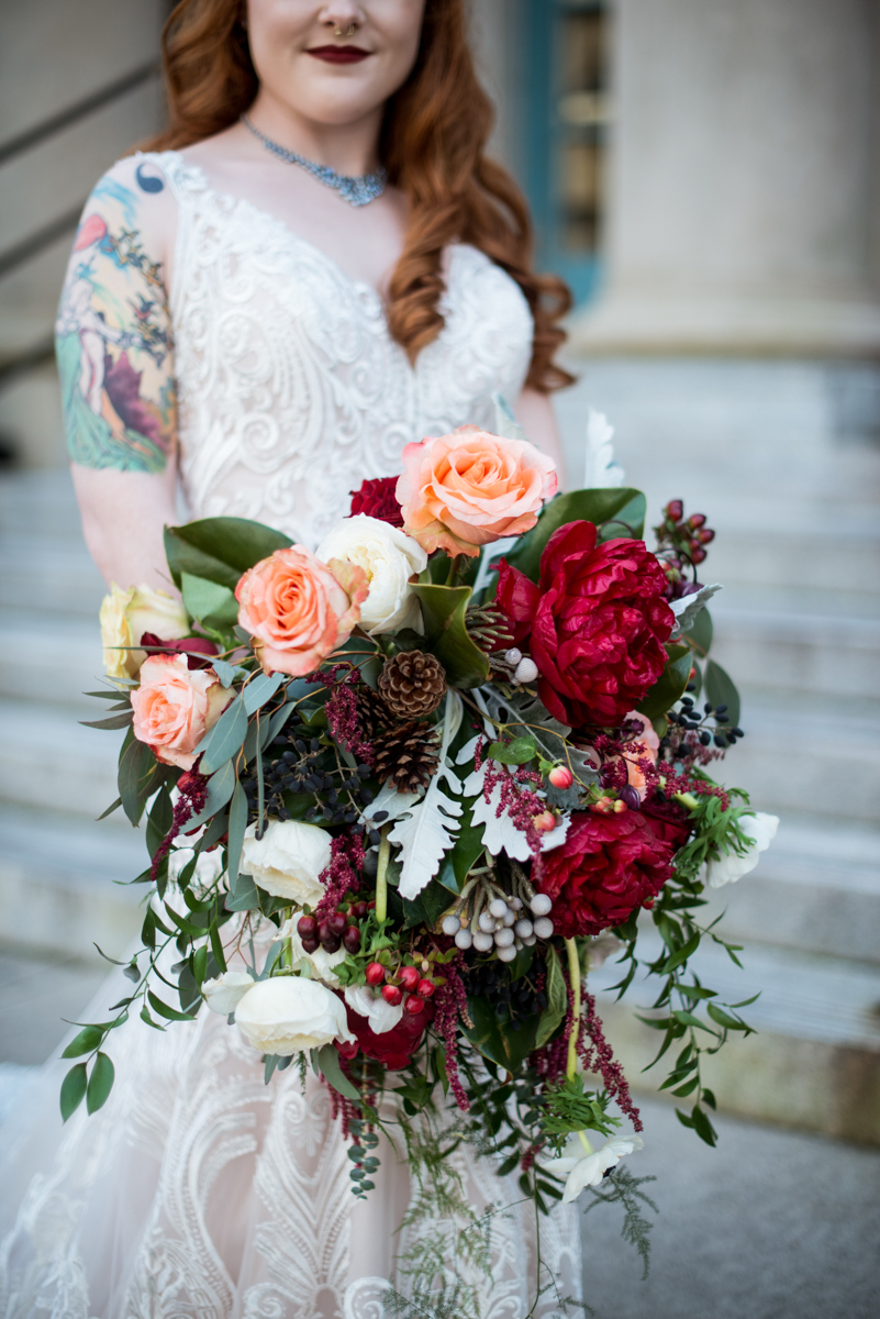 Lush Winter Wedding with Red and Gray | Cascading Red and Pinecone Winter Bouquet