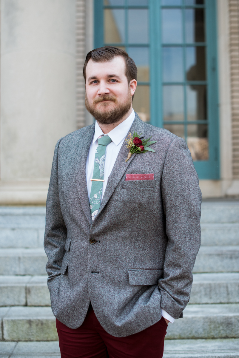 Lush Winter Wedding with Red and Gray | Groom with Gray and Red Suit