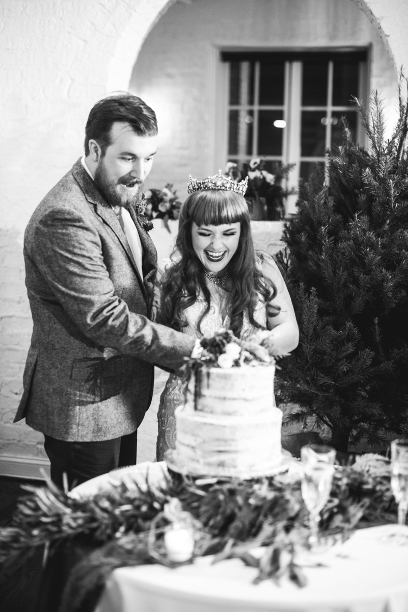 Vintage Winter Wedding with Red and Gray | Bride and Groom Cake Cutting