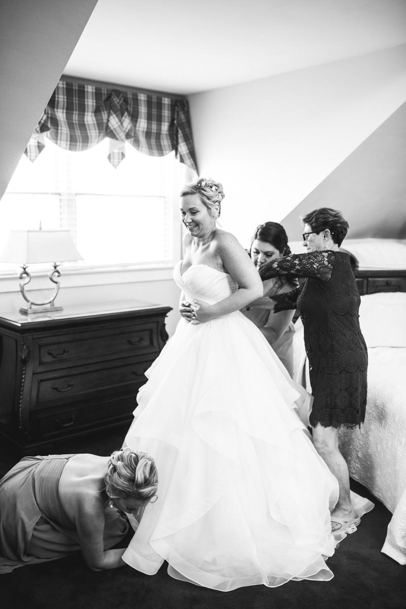 Elegant Summer Wedding in Smithfield, Virginia | Bride getting dressed