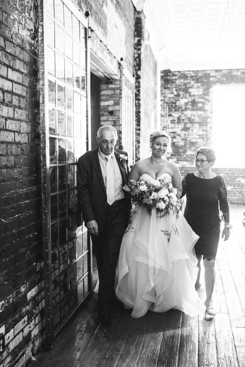 Elegant Summer Wedding in Smithfield, Virginia | Bride walking down aisle