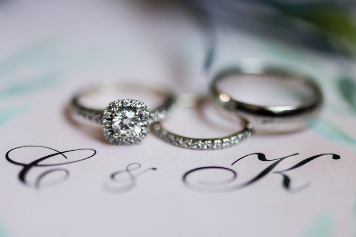 Intimate Summer Micro Wedding | Invitation ring shot