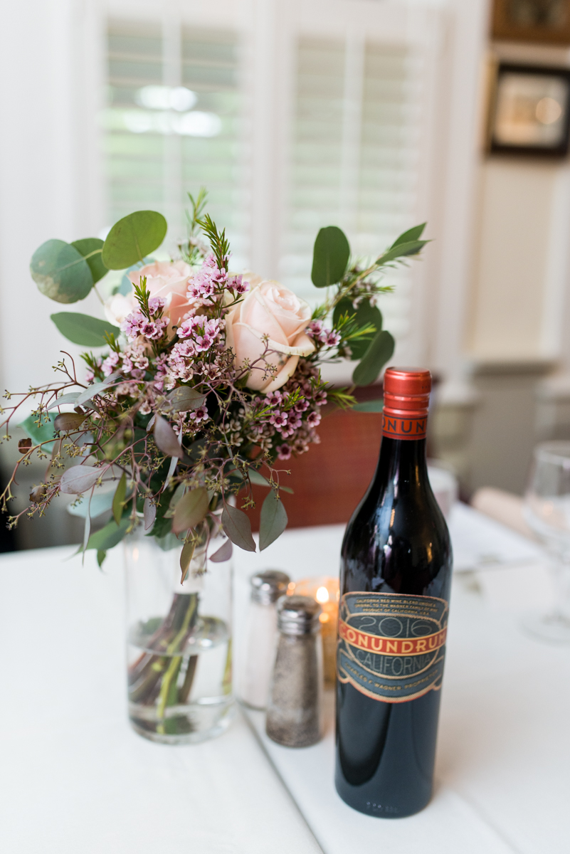 Intimate Summer Micro Wedding | Wine bottle reception centerpieces