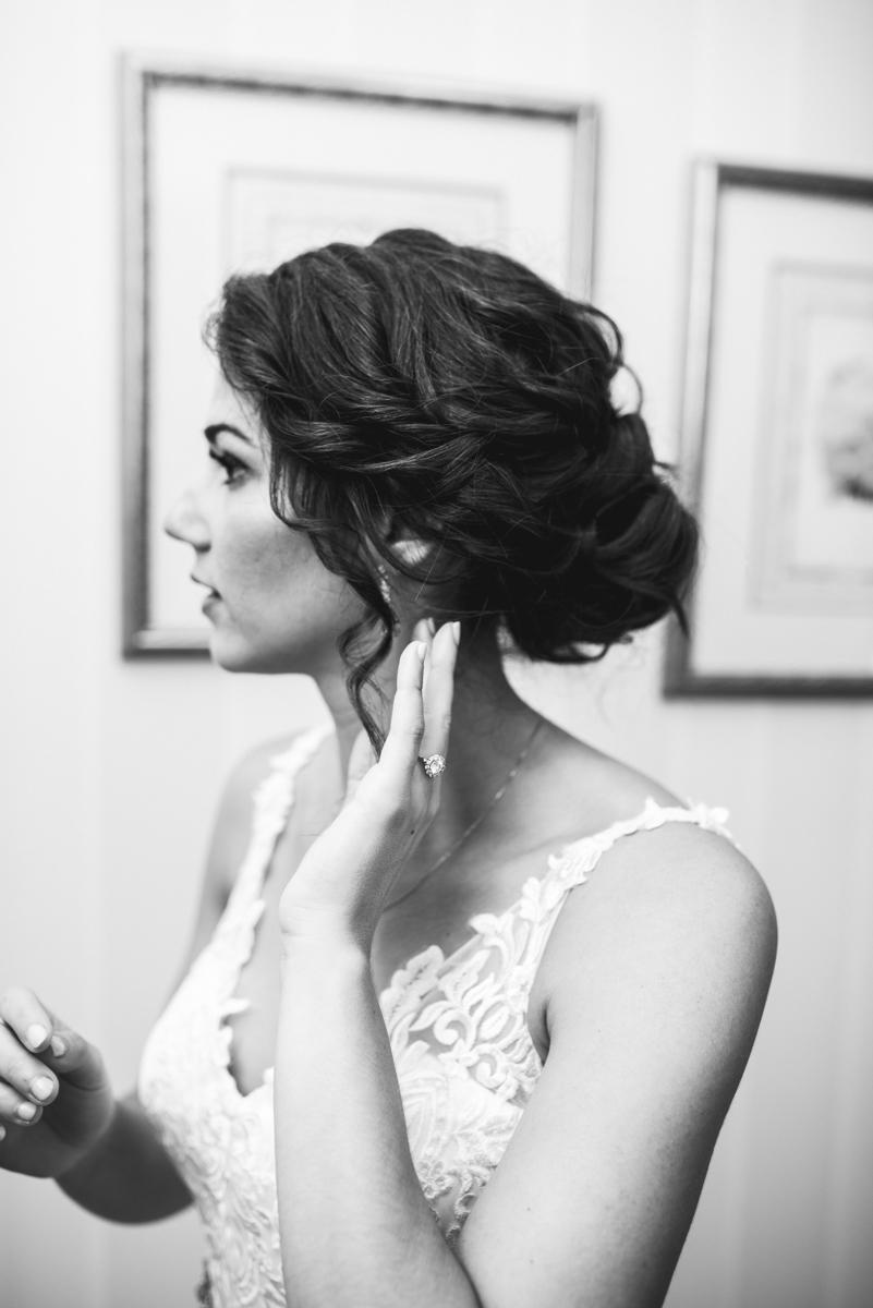 Jewish Summer Wedding in Williamsburg | Bride putting on earrings