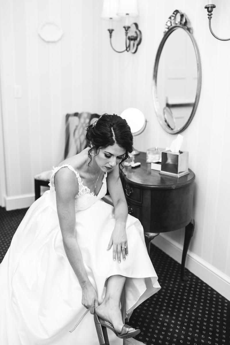 Jewish Summer Wedding in Williamsburg | Bride putting on shoes