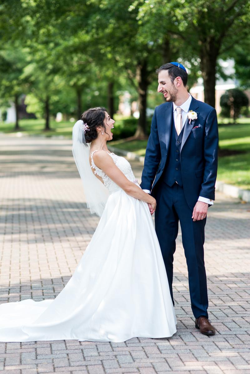 Jewish Summer Wedding in Williamsburg | Bride and groom joyful wedding pictures