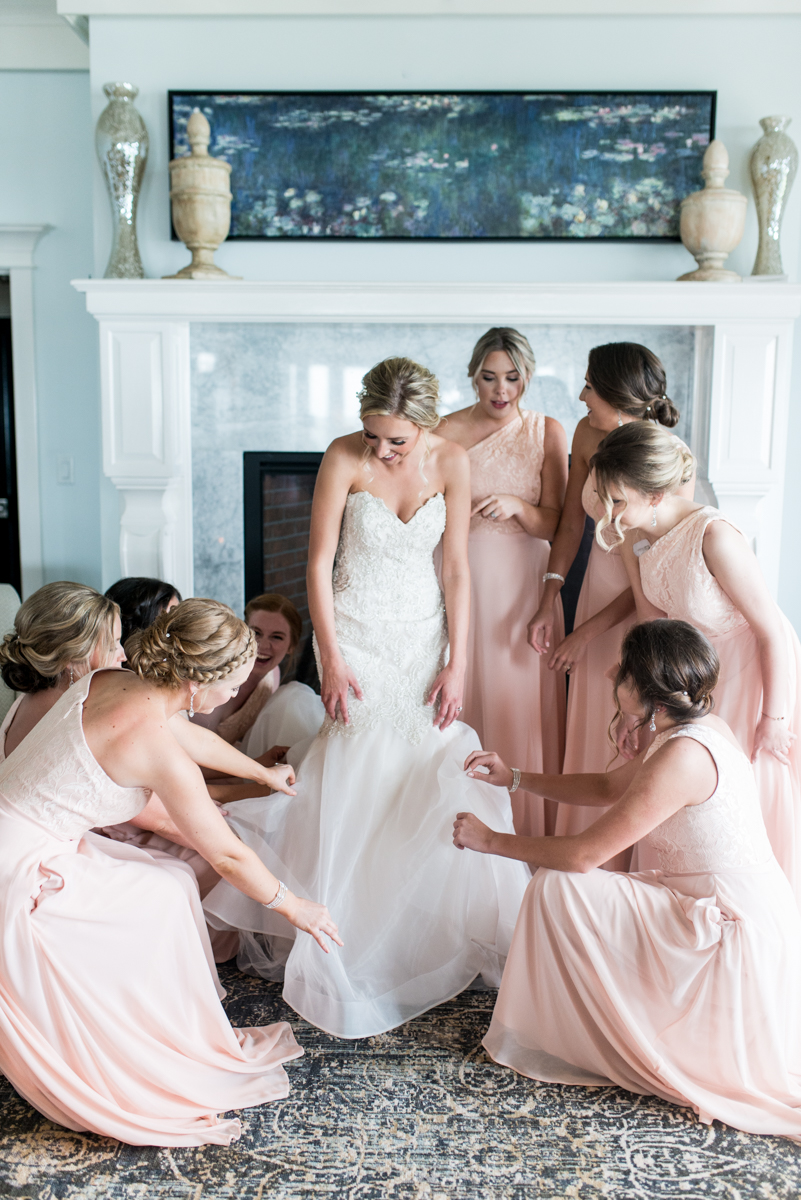 Blush and Gold Military Wedding | Bridesmaids helping bride get ready