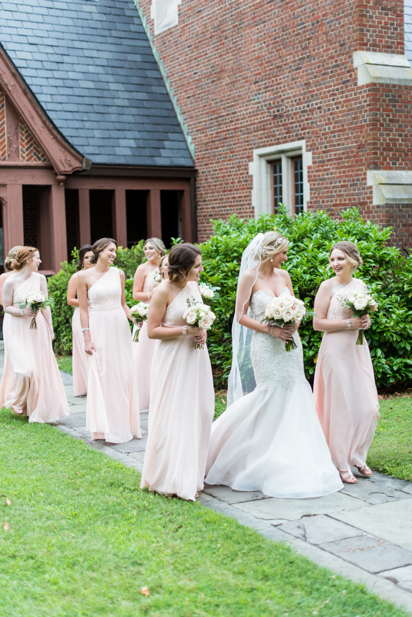 Blush and Gold Military Wedding | Bride walking with her bridesmaids