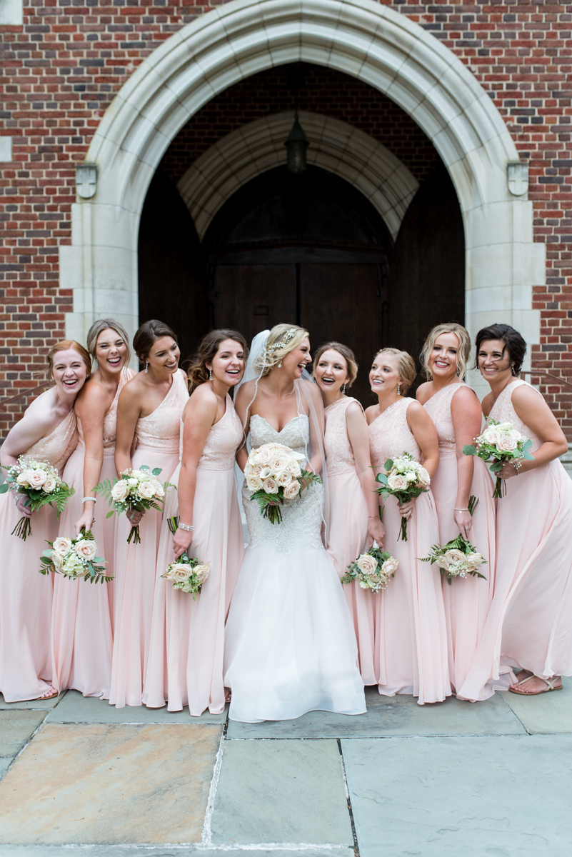 Blush and Gold Military Wedding | Casual and fun bridesmaid pictures with large bridal party
