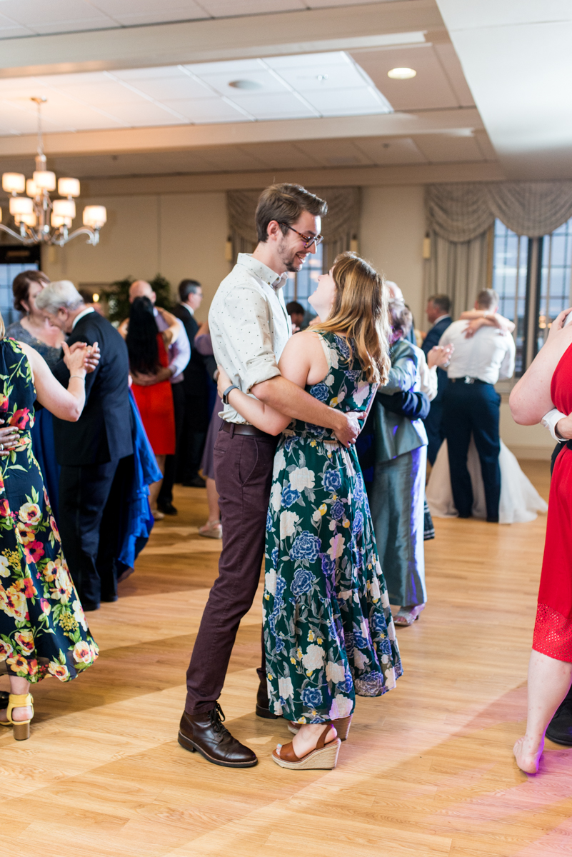 Blush and Gold Military Wedding | Wedding guests dancing at reception