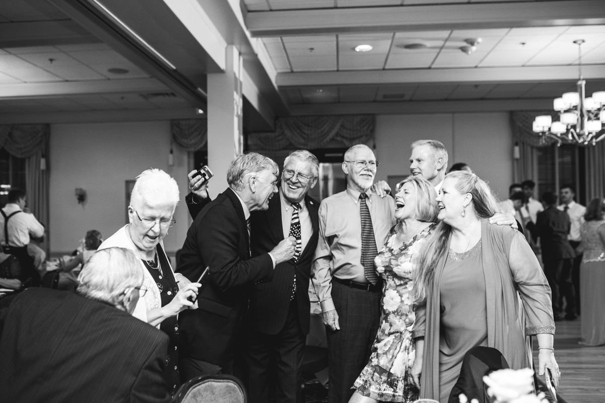 Blush and Gold Military Wedding | Wedding guests laughing at reception
