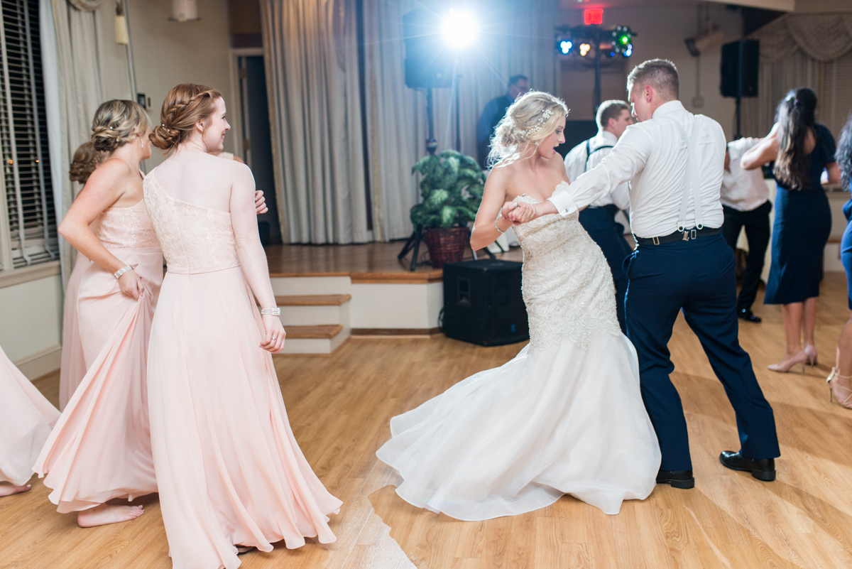 Blush and Gold Military Wedding | Bride and groom dancing at reception
