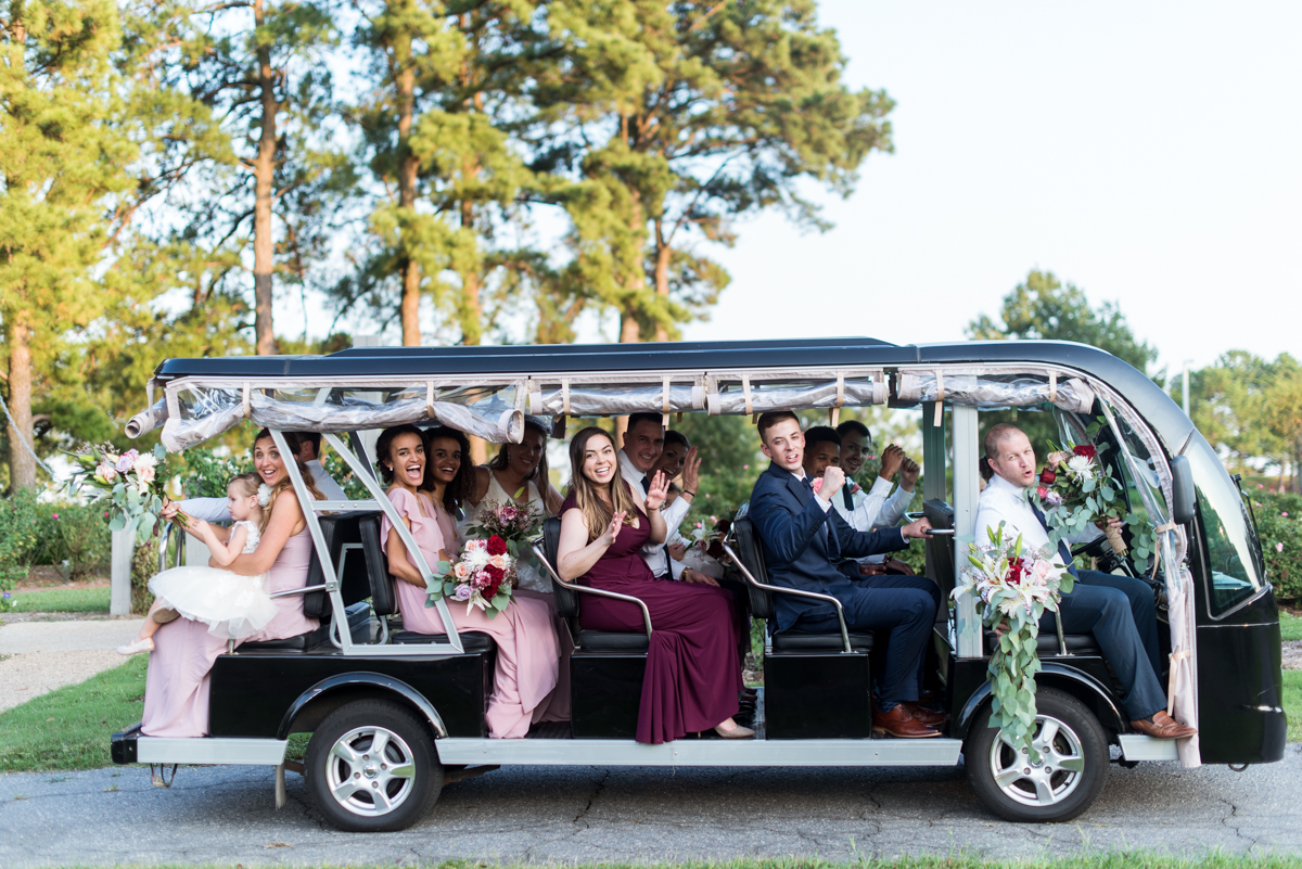 Bright Fall DIY Wedding | Bridal party in golf cart