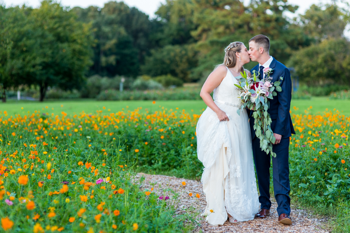 Bright Fall DIY Wedding | Bride and groom pictures in wildflower field