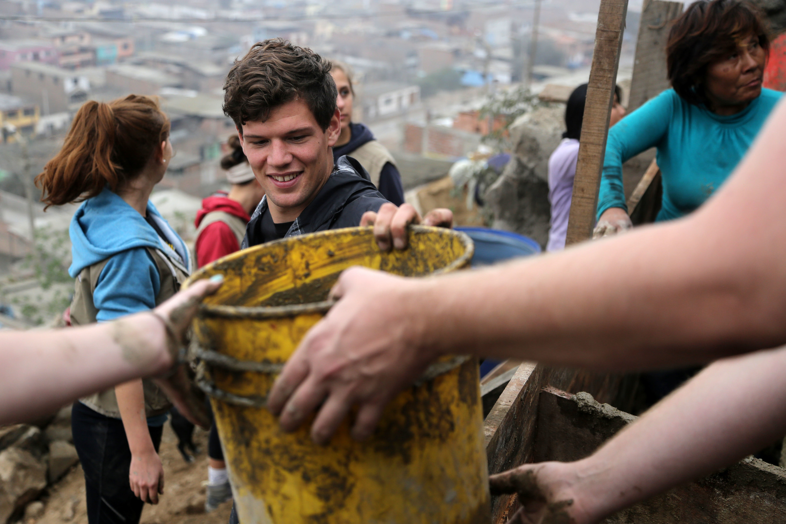 My roommates and community members were working on a staircase project in Villa Maria, Lima, Peru. I was, of course, documenting.
