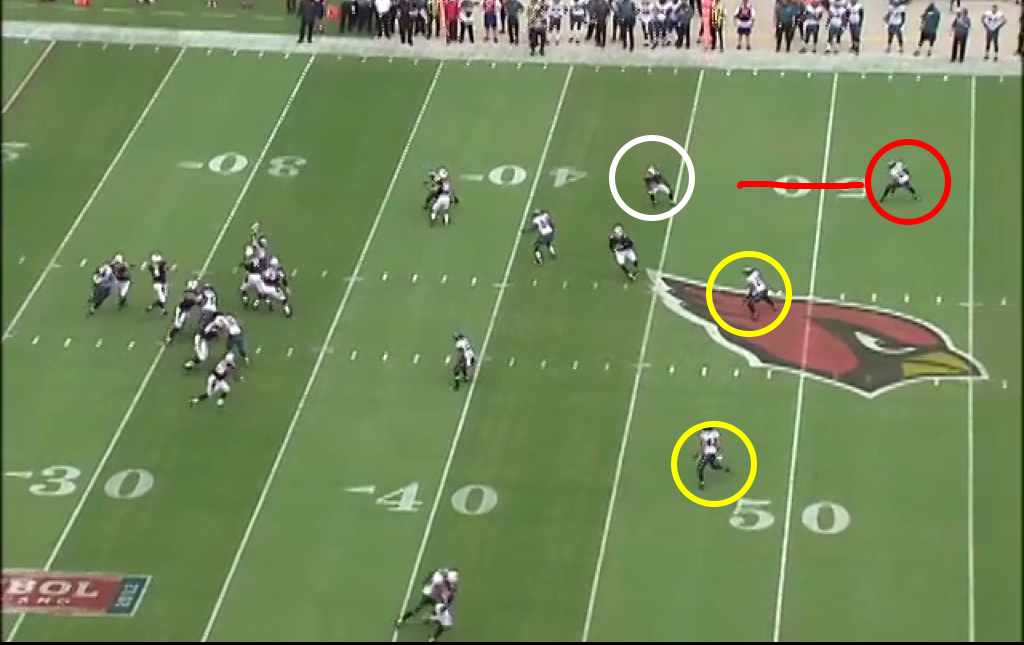 With the Eagles in Cover 3, Nnamdi drops way back, leaving space open.