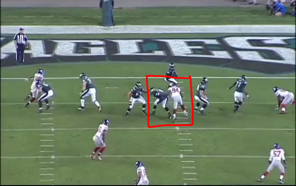 Kiwanuka, playing nose guard, manhandles Reynolds while Mathis looks the other way.