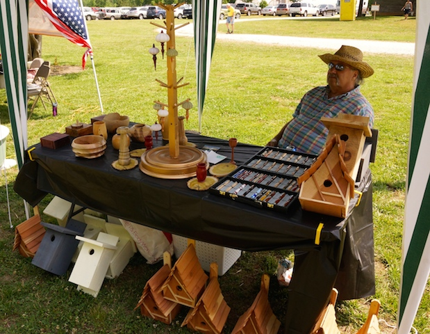 Dennis Taylor shows his woodworking wares.