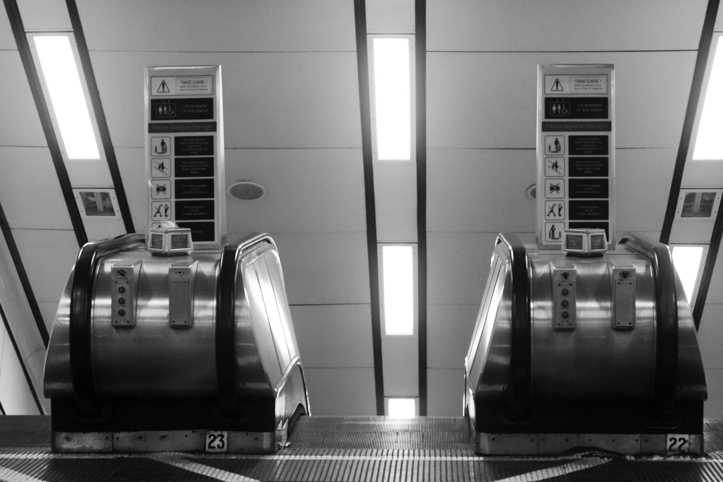 The Escalator. Click on the image to read the poem at The Jupiter Project.