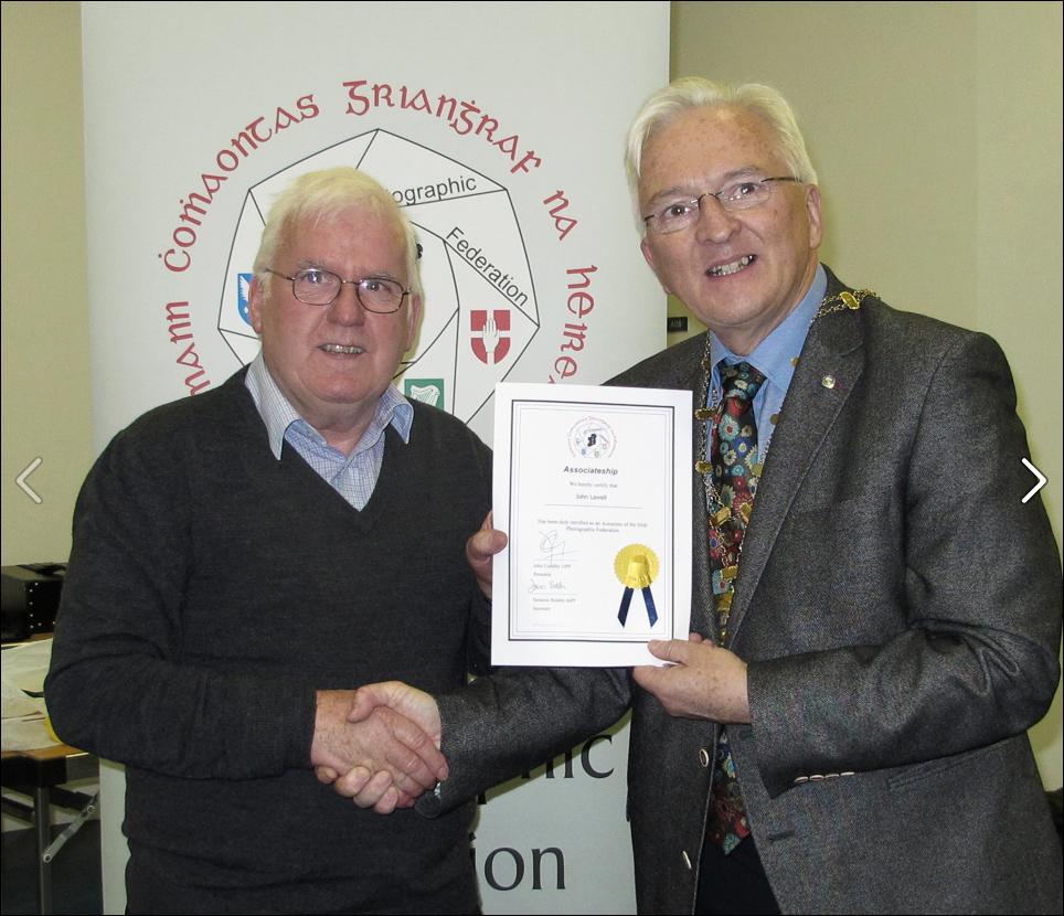 John receiving his accreditation
