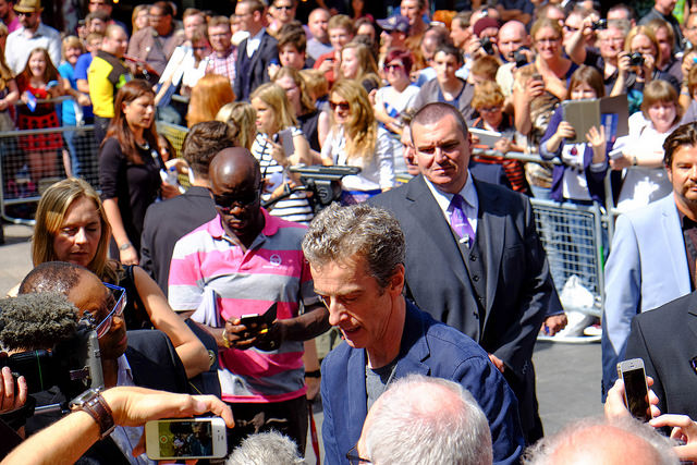 Peter Capaldi doing the signing thing...