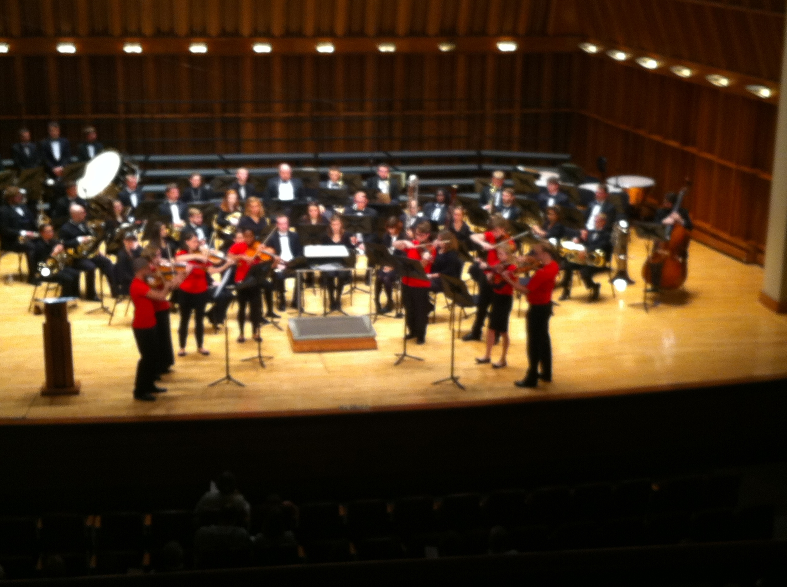 BSUVC in performance, with the Wind Ensemble on stage and ready to play.