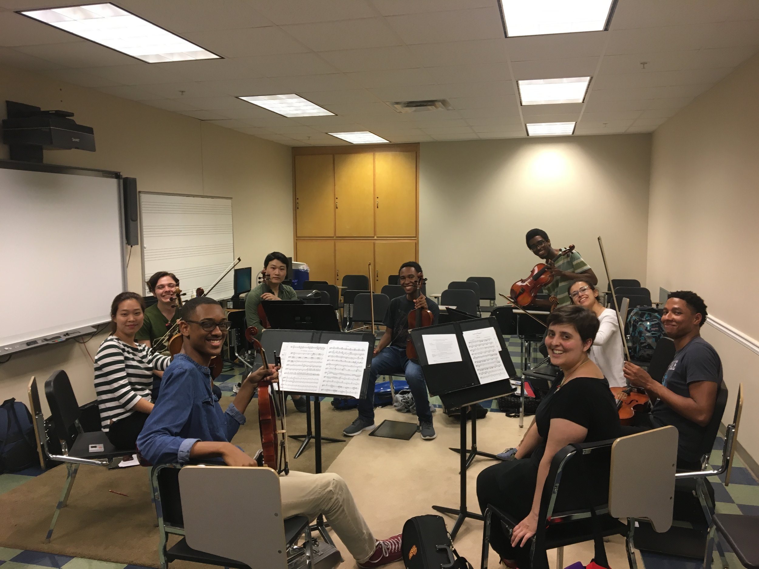 Nine of eleven wonderful viola students getting ready for sectionals.