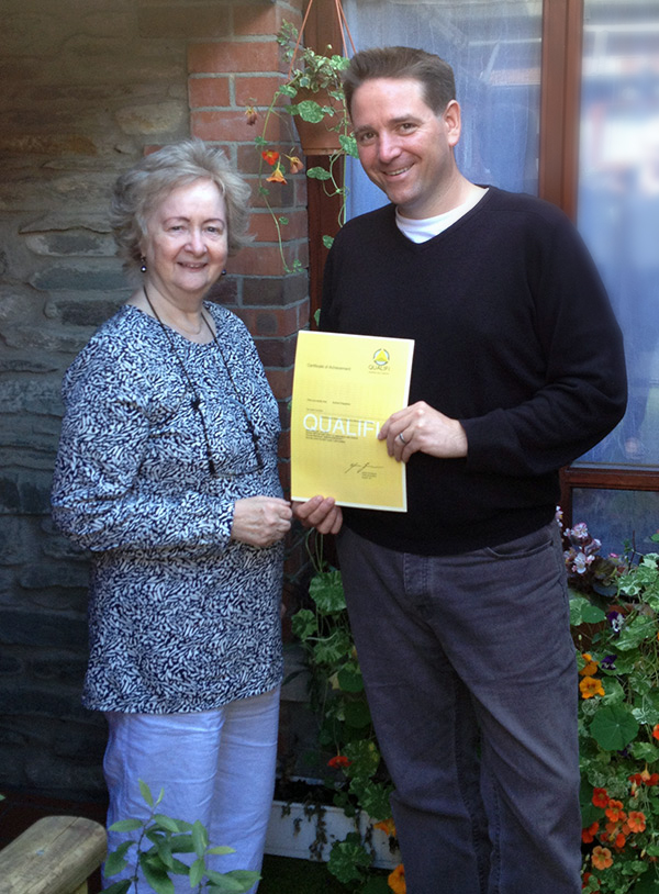 Andrew Fitzpatrick, Counsellor at White Oaks Rehabilitation Centre, receiving his Practitioner's Diploma in CBT from Dr Helena Schlindwein Ph.D. FNCP, Director of CHATS.